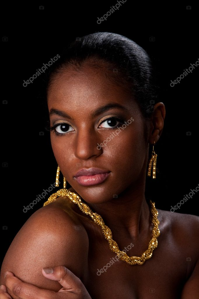 Face of beautiful African American woman with gold earrings and necklace, isolated.  Stock Photo #2689164