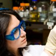 Scientist looking at test tube - Stock Photo