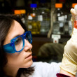 Stock Photo: Scientist looking at test tube