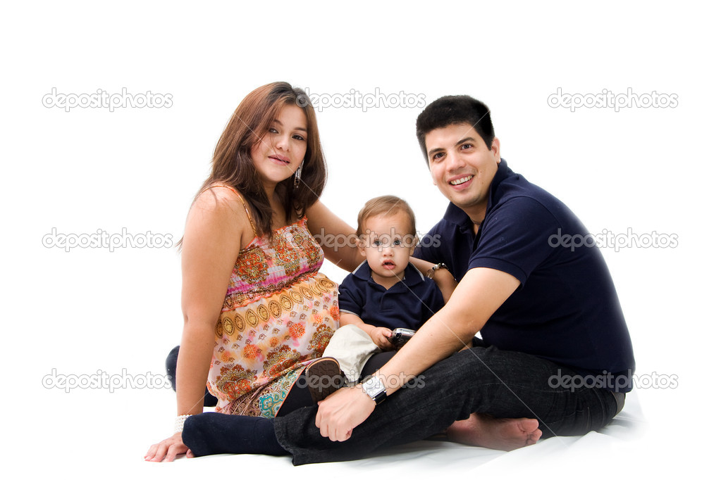 Mother, father and son as a young new family sitting together, isolated — Stock Photo #2739613