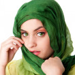 Постер, плакат: Face with green eyes and scarf