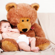 Baby with bear — Stock Photo
