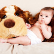 Baby with dog — Stock Photo