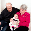 Grandparents with baby girl — Stock Photo