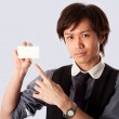 Asian business man pointing at card — Stock Photo