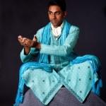 Hindu man sitting in lotus position — Stock Photo