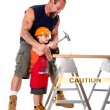 Father teaching son construction - Stock Photo