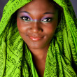 Smiling African woman with headwrap — Stock Photo