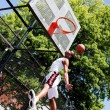 Jumping basketball player — Stock Photo