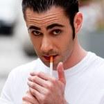 Man lighting cigarette — Stock Photo