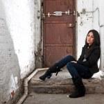 Girl sitting in basement — Stock Photo