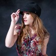 Mysterious girl with hat — Stock Photo