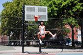 Jumping basketball player — Stock Photo