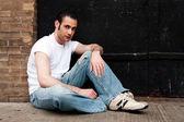 Man sitting on concrete — Stock Photo