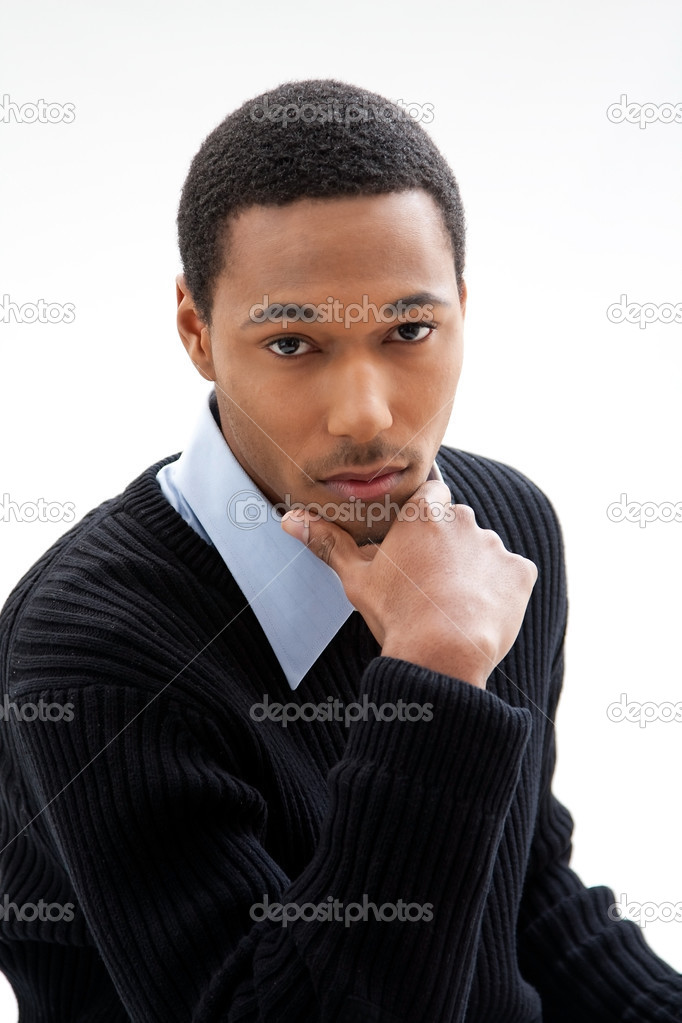 Handsome African American male in blue shirt and black sweater, isolated  Stock Photo #2767949