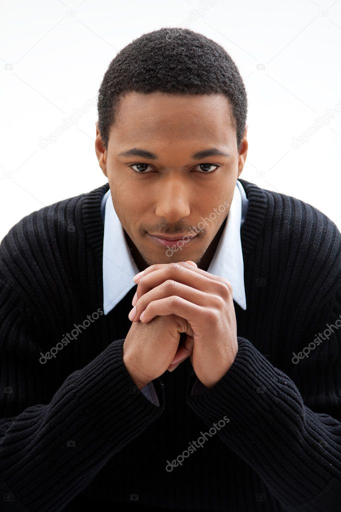 Handsome African American male in blue shirt and black sweater, isolated — Photo #2767967