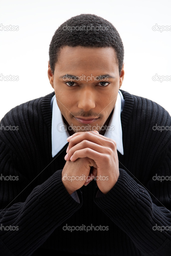 Handsome African American male in blue shirt and black sweater, isolated — Stock Photo #2767967