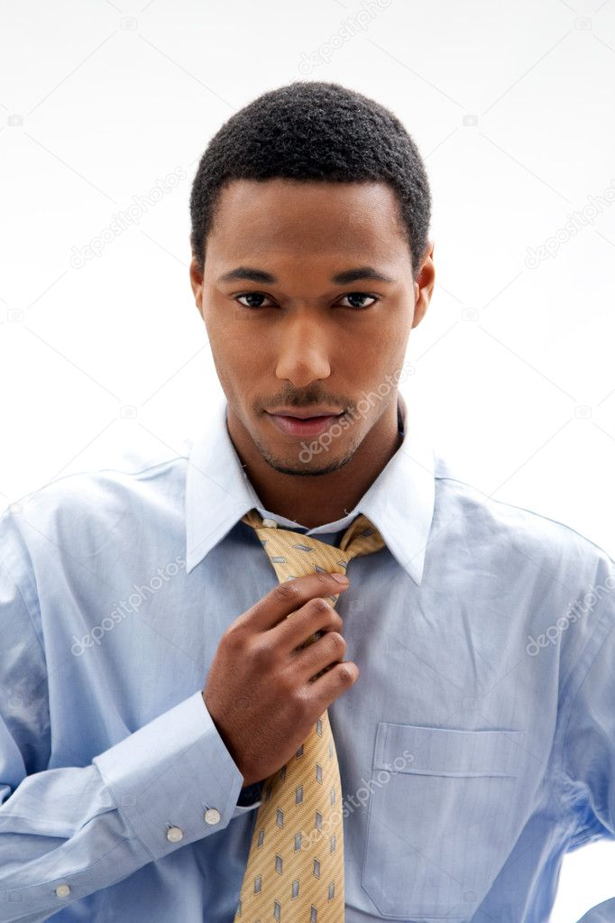 Handsome African American male in blue shirt and yellow tie, isolated — Stock Photo #2767981