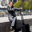 Traveling business woman on phone — Stock Photo