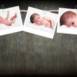 Cute baby photos hanging on rope — Stock Photo