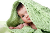 Cute happy baby between green blankets — Stock Photo