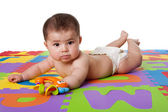 Cute baby laying on belly — Stock Photo