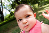 Funny baby face with big cheeks — Stock Photo
