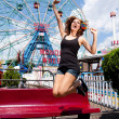 Girl having fun in amusement park - Stock Photo