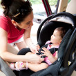 Baby in car seat for safety — Photo