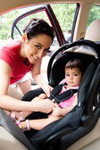 Baby in car seat for safety — Stockfoto