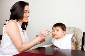 Infant eats messy — Stock Photo
