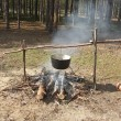 Kettle on fire in spring forest — Stock Photo