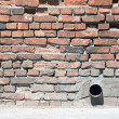 Brick wall with tube — Stock Photo