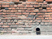 Brick wall with tube — Fotografia Stock