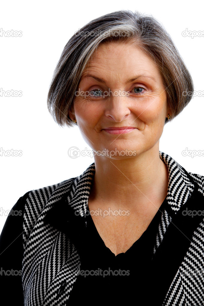 This picture is of a mature, but still modern, businesswoman — Stock Photo #3162554