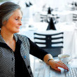 Older Businesswoman with Coffee and Internet - Stockfoto