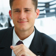 Handsome smiling businessman - Stock Photo