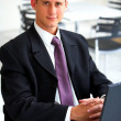 Businessman at an airport restaurent - Stock Photo