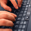 Royalty-Free Stock Photo: Fast hands typing on Laptop