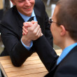Royalty-Free Stock Photo: Two competing businessmen arm wrestling