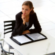 Young businesswoman wondering - Stock Photo