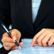 Young businesswoman signing a contract - Foto Stock