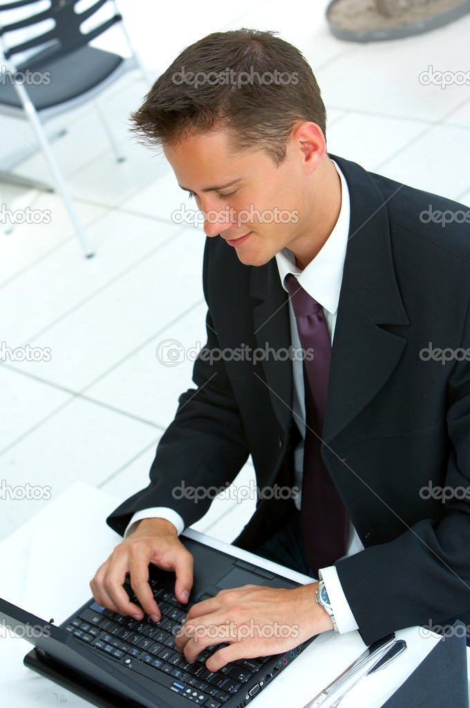 Businessman at an airport restaurent taking a break. 2 weeks of location research went into finding this light, clear and simplistic restaurent. — Stock Photo #3197456