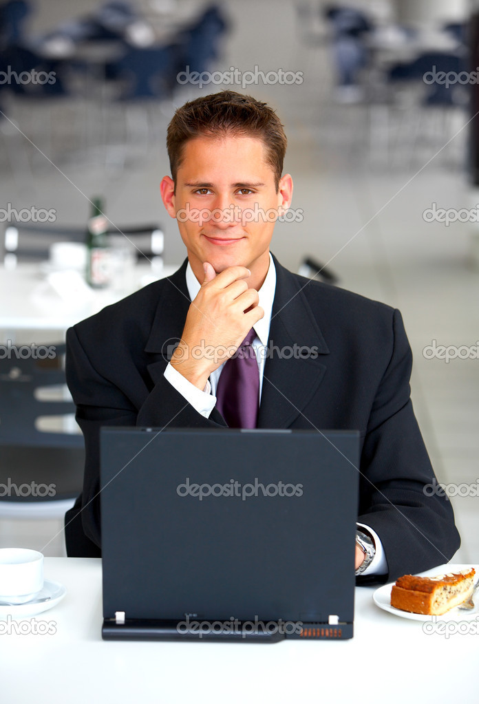 Businessman at an airport restaurent taking a break. 2 weeks of location research went into finding this light, clear and simplistic restaurent. — Stock Photo #3197554