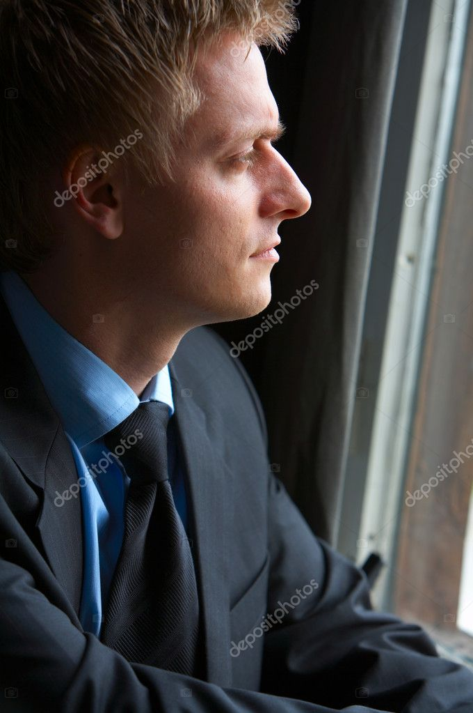 Young Businessman full of ideas looking out of window. Camera: 12,8mp full frame Canon 5D, using mostly a Canon 70-200mm 2.8L USM IS.  — Stock Photo #3197748