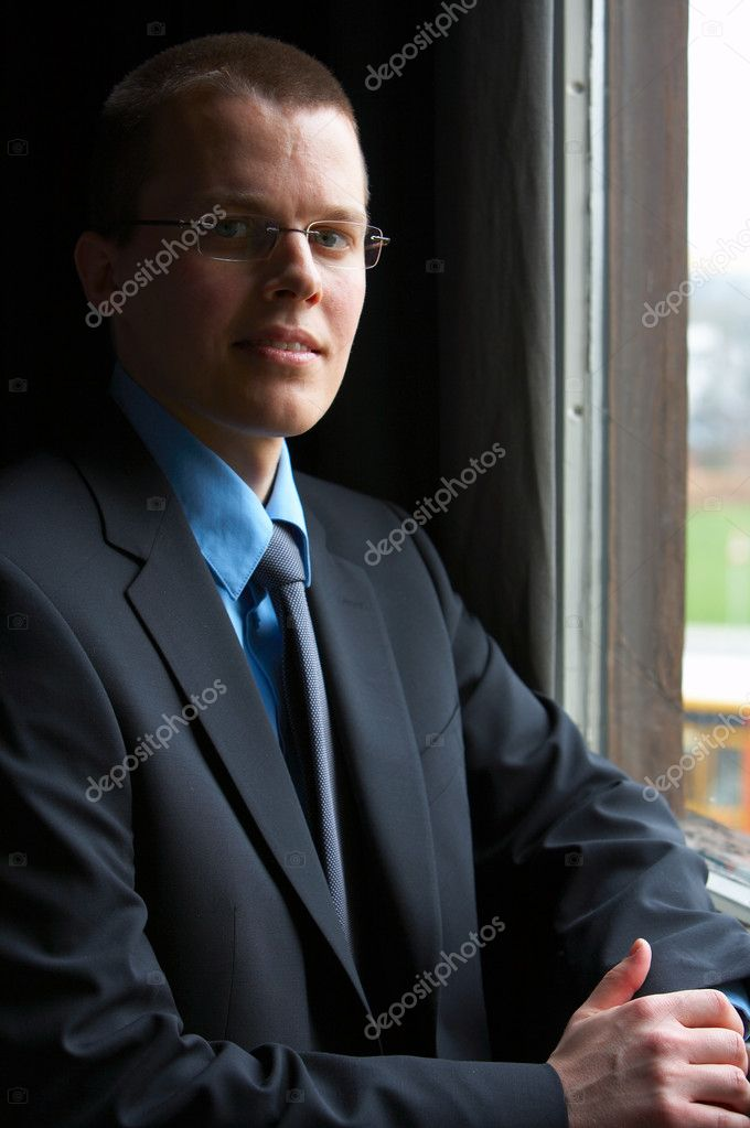 Young Businessman full of ideas looking out of window. Camera: 12,8mp full frame Canon 5D, using mostly a Canon 70-200mm 2.8L USM IS.  — Stock Photo #3197765