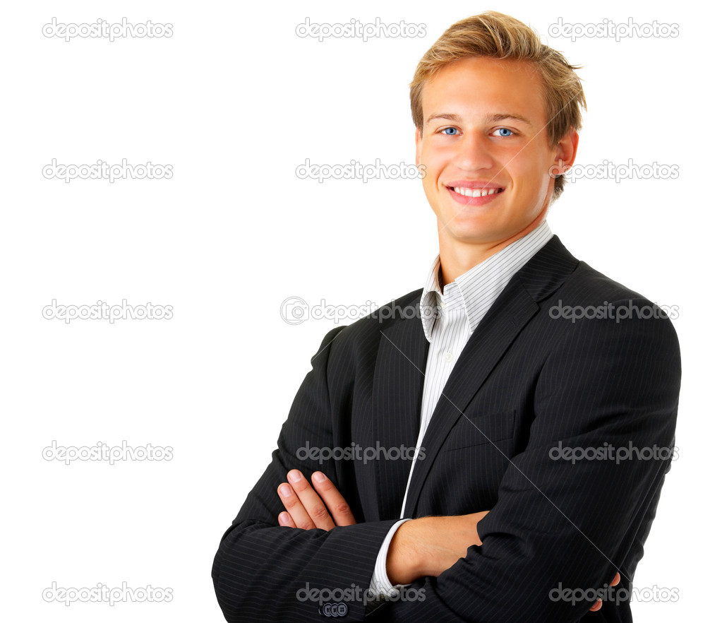 Portrait of a young businessman standing comfortably.   Stock Photo #3198178