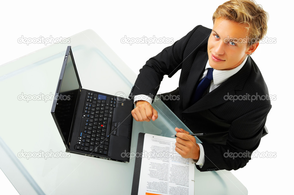 Business man working by desk - Portrait of a handsome young man in a business suit working.  — Stock Photo #3198252