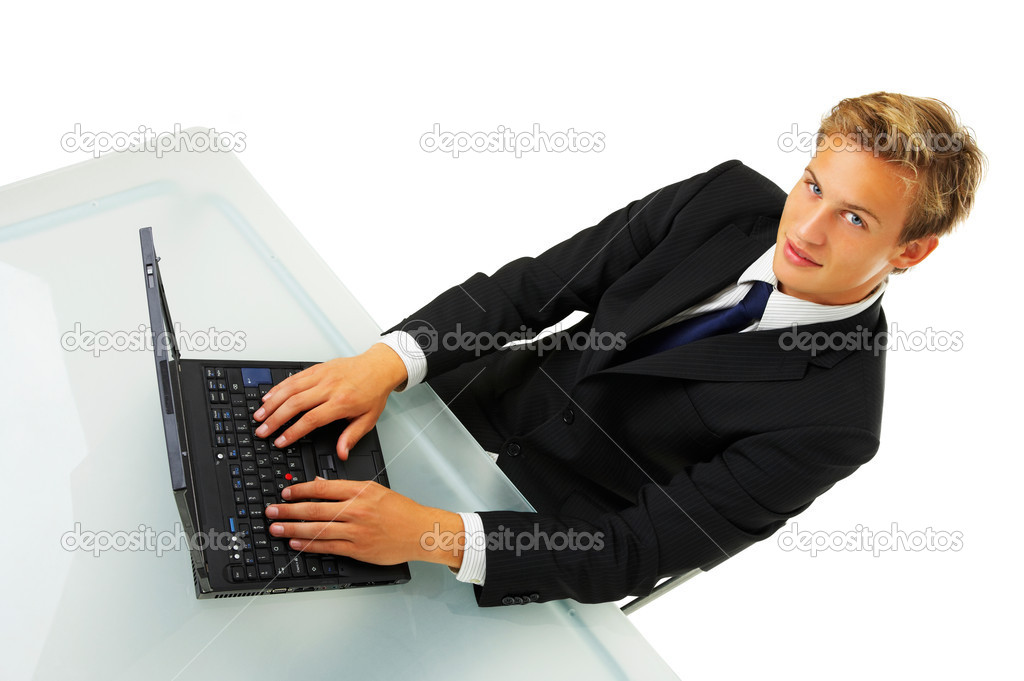 Business man working by desk - Portrait of a handsome young man in a business suit working.  — Stock Photo #3198256