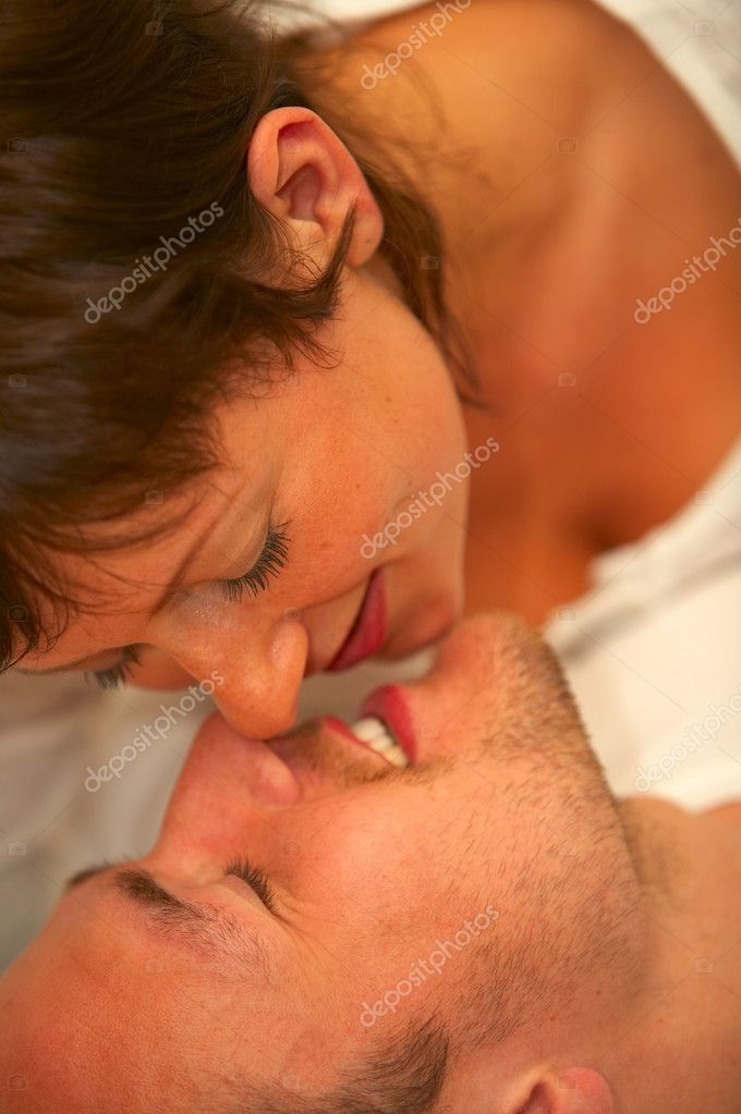 A young couple kissingThe concept is: Summer love, romance and a happy lifestyle.  — Stock Photo #3199290